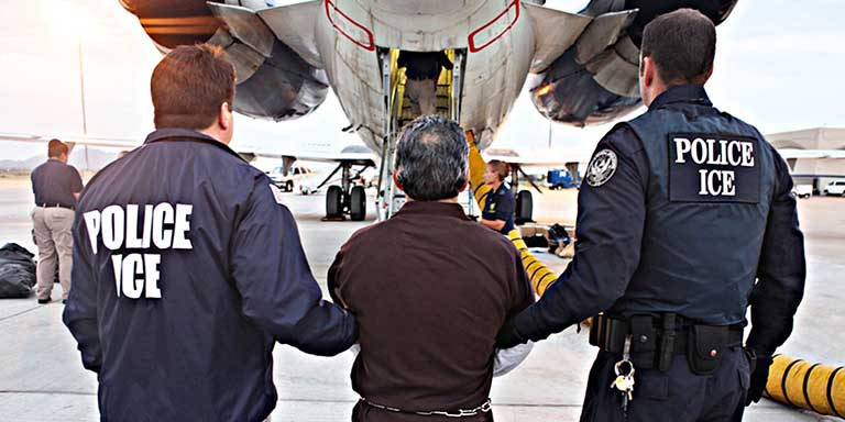 Federal immigration agents board Hispanic man onto a plane
