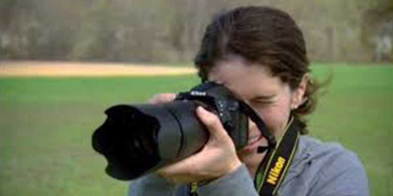 woman pointing a camera forward to take a picture